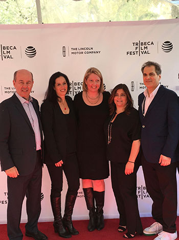 Bergan at the 2016 Tribeca Festival premiere of Midsummer in Newtown with the film's director and co-executive producers.