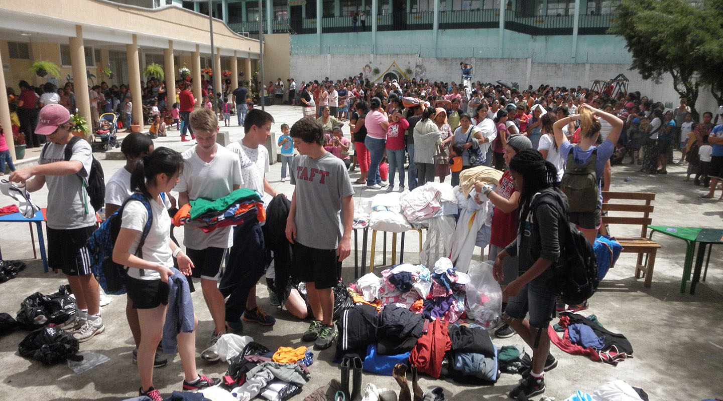 Students help out at the massive clothing distribution.