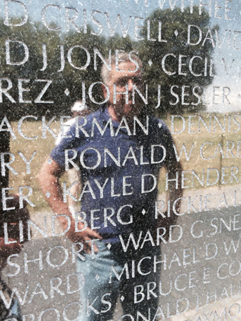 Jon Dann '70 reflected on the Vietnam Veterans Memorial wall. Dann produced a documentary about veterans and PTSD in 1982, when it was a relatively new diagnosis. JULIE MALLORY