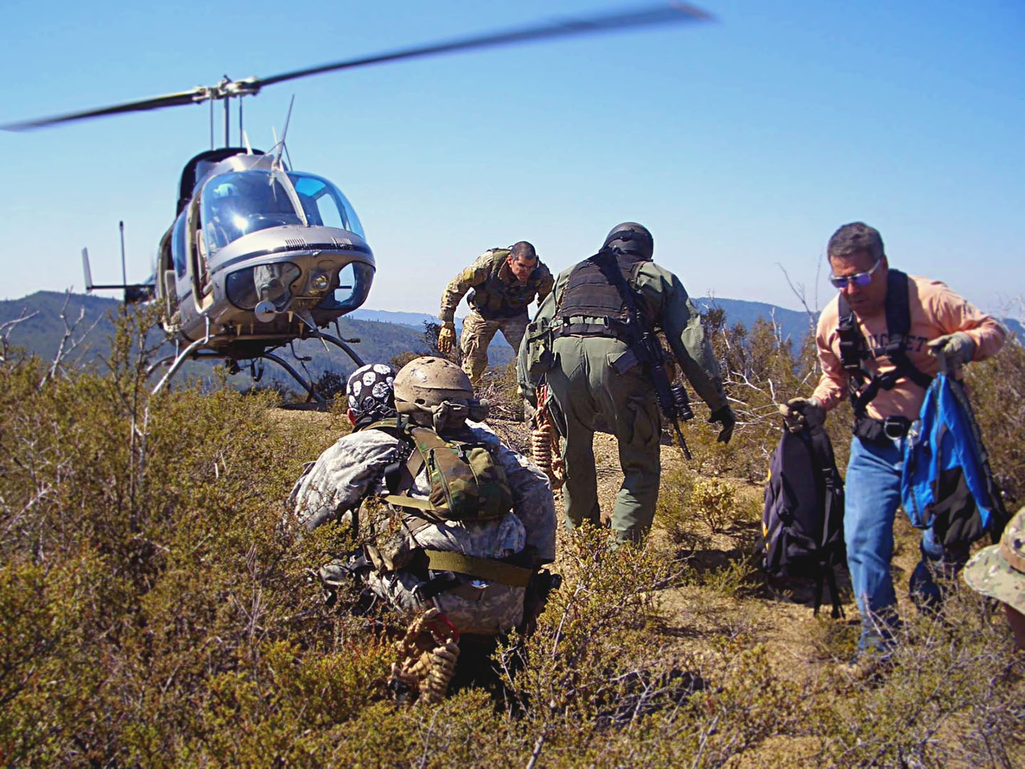 Dann (far right) with a DEA operation during the filming of his documentary Marijuana Inc. DAVID DELLARIA