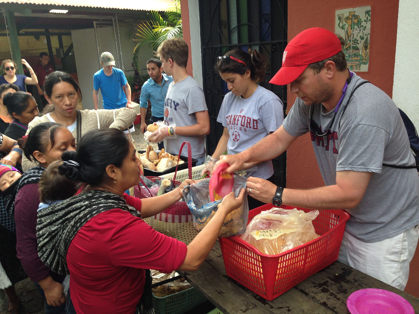 Spanish teacher Jon Bender and Taft students help out with food donations.