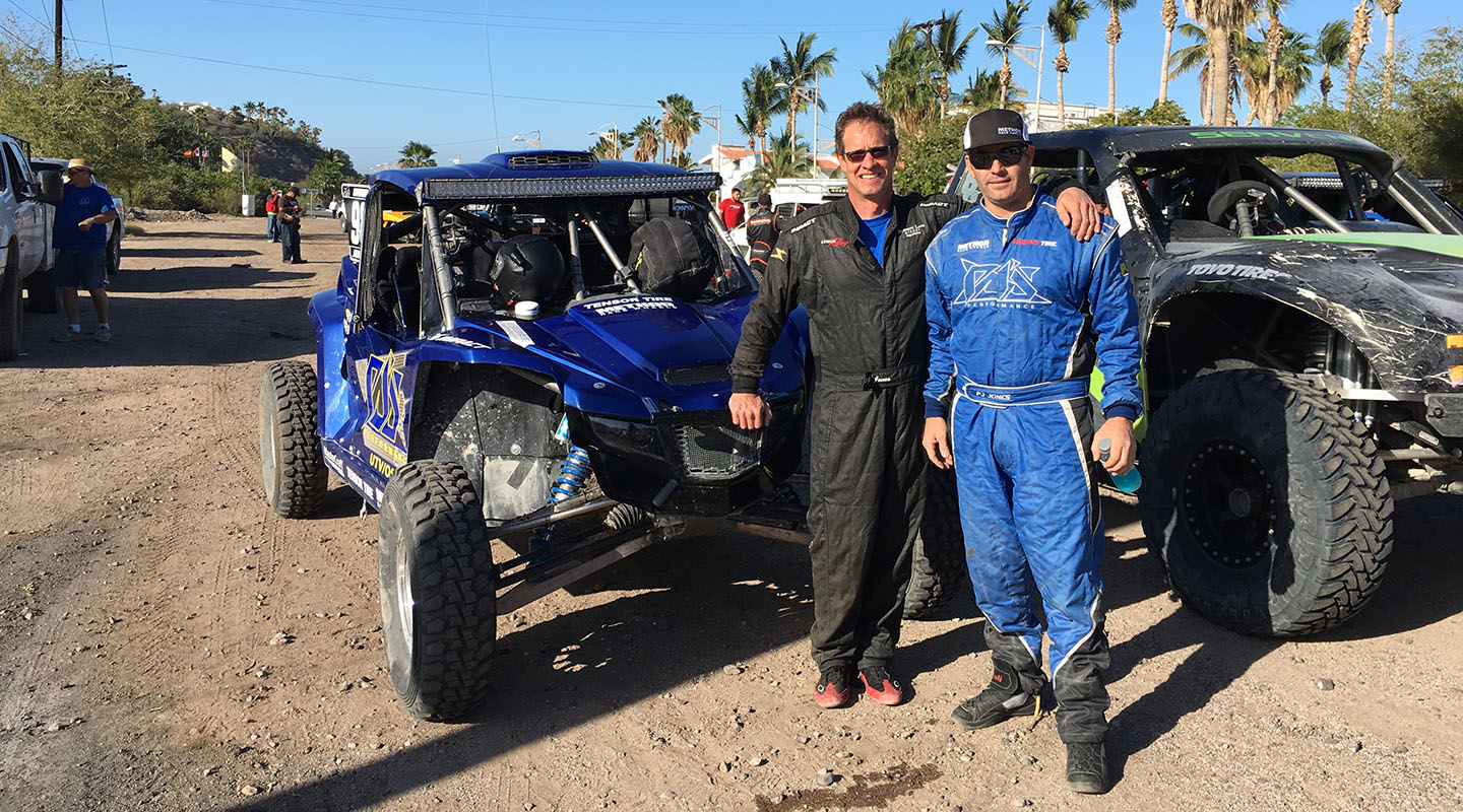 Driver Nick Firestone '84, left, at the 50th anniversary of the NORRA 1000, a Mexican off-road/rally race, with his co-driver/navigator PJ Jones, son of Parnelli Jones, the 1963 Indy 500 winner and one of the best drivers in the U.S. Their fathers used to race in the Baja 1000 and other off-road races at the same time, but this was the first time that Nick and PJ had ever raced together.
