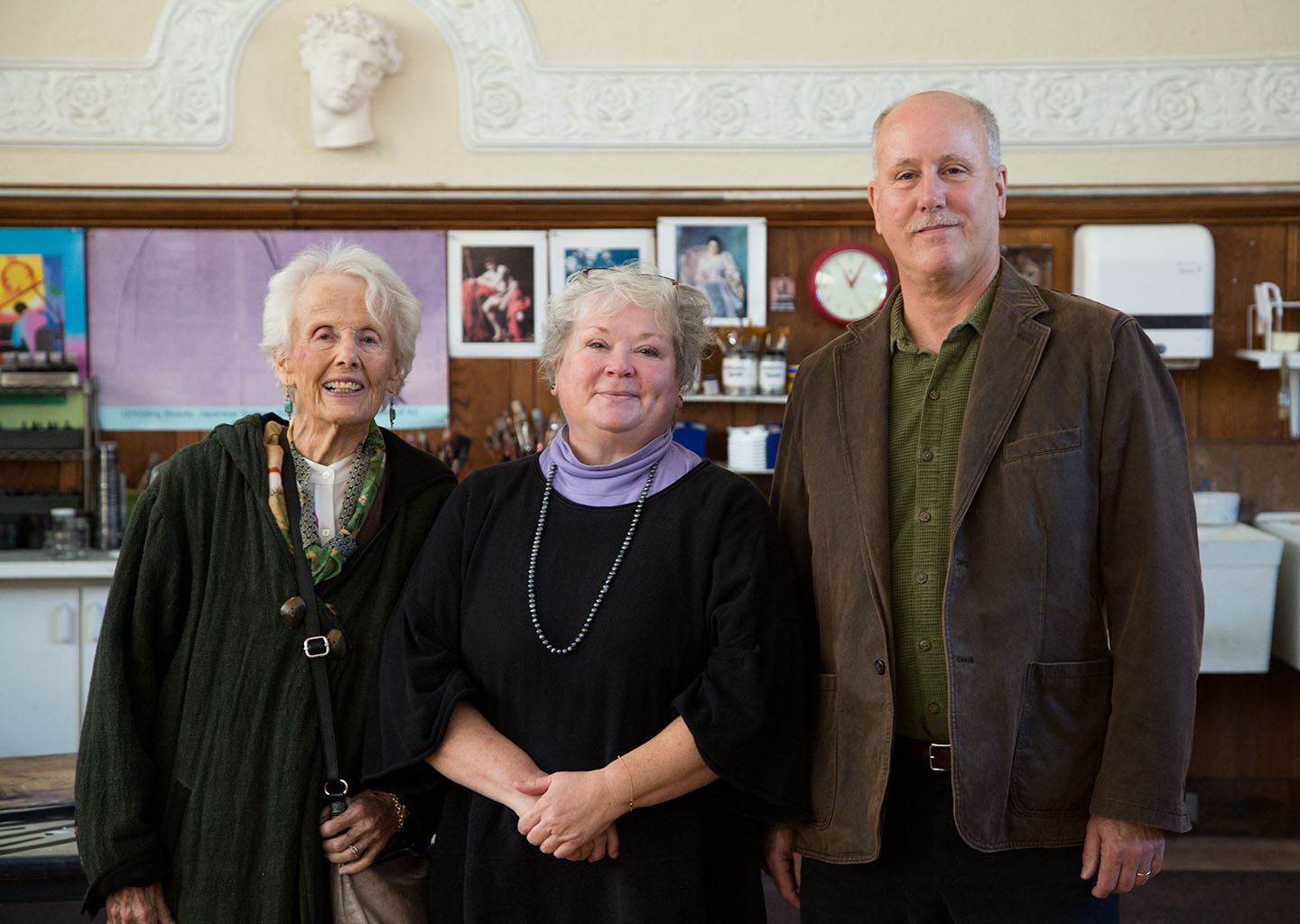 Priscilla Rockwell, whose late husband, Deever, cofounded the Rockwell Visiting Artists Program, and their son Taylor Rockwell '72, right, on campus with art teacher Loueta Chickadaunce. ANNE KOWALSKI