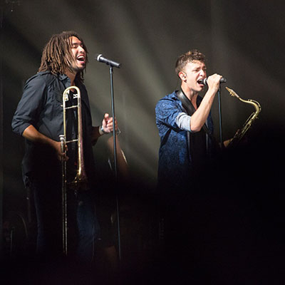 Gonzalez, at left, singing background vocals, along with playing trombone, while on tour with Grammy-winning Latin pop superstar Alejandro Sanz. JEN DEV
