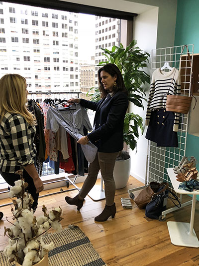 Vanessa LeFebvre Robinson '95 goes over a product review with one of Stitch Fix's directors, who shows product that is currently popular that the team will rebuy for future fixes.
