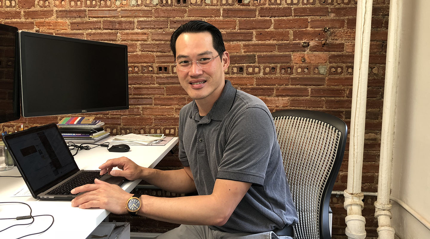 Univision's vice president of product and engineering, Clarence Kwei '91, at work in their New York City office.