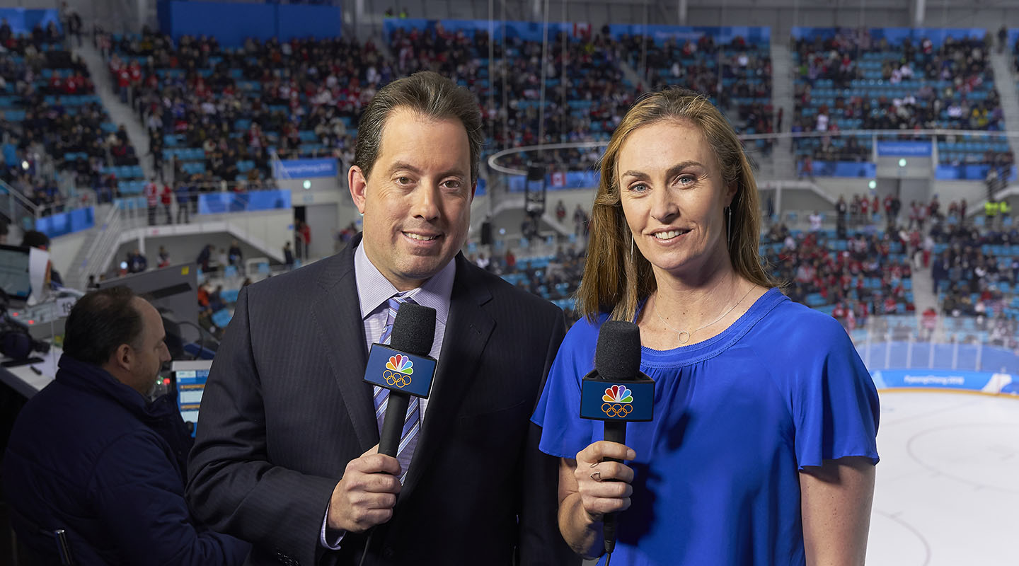 Former Olympic gold medalist AJ Mleczko '93 at the 2018 PyeongChang Olympics for her fifth assignment as NBC's women's hockey analyst, pictured with commentator Kenny Albert. NBC SPORTS GROUP