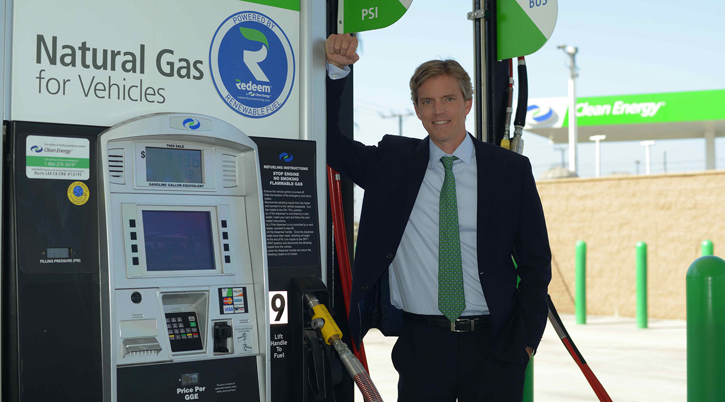 Harrison Clay '92 at a biomethane vehicle fuel pump. CLEAN ENERGY