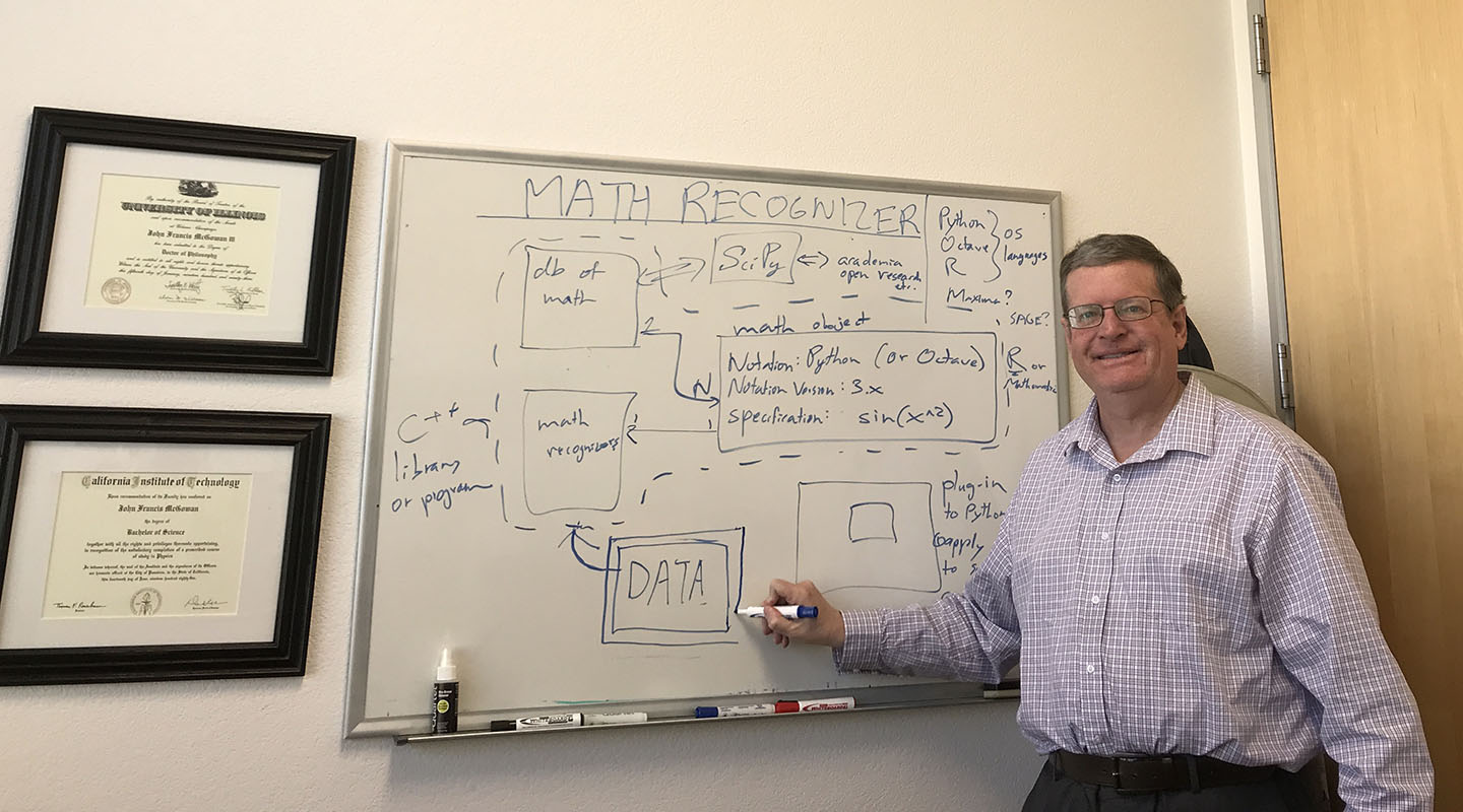 John McGowan '81 draws a block diagram for his software product Math Recognizer for a technical presentation, showing how it is integrated with current analysis tools.