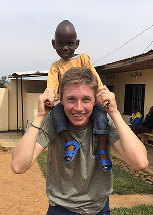 Alex Robertson '20 with a child from Nyamata
