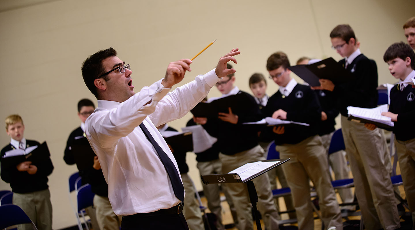 Christopher Eanes '94, artistic director and CEO of the Cincinnati Boychoir, conducts a rehearsal