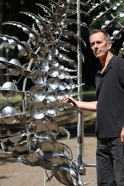 Howe with another of his sculptures.