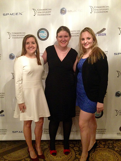 Jane Kinney '06, far right, assistant director of the Commercial Spaceflight Federation, at its 10th anniversary reception, with two colleagues.