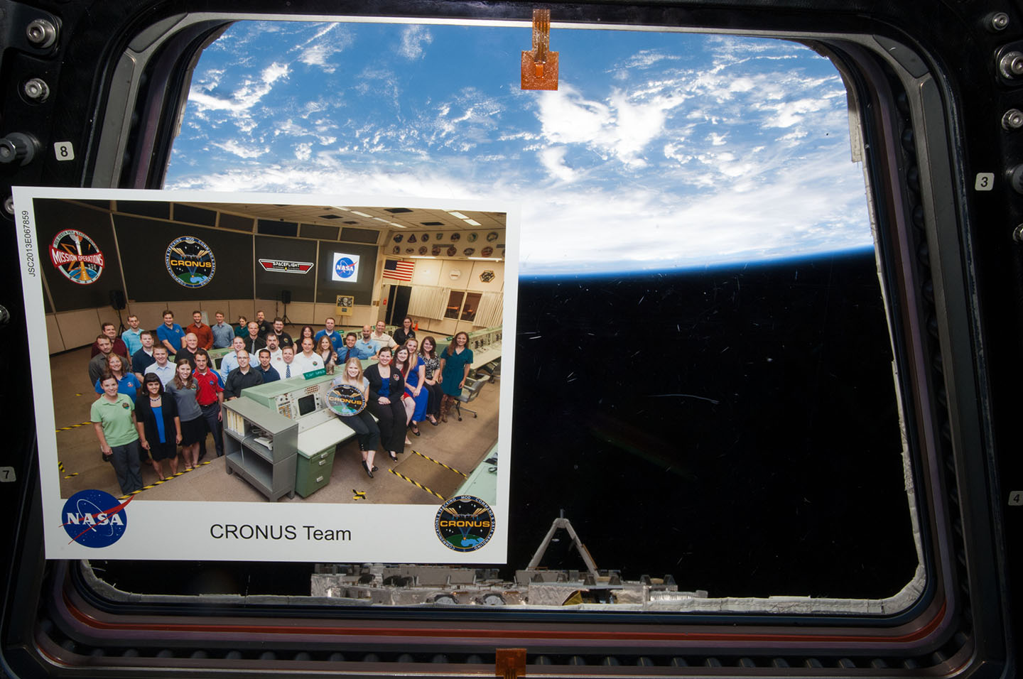 A photo of Kinney's group at NASA, CRONUS, inside the International Space Station, brought by one of the astronauts as a thank you to the team Kinney worked with. (She is in the front seated row, fourth from left.)