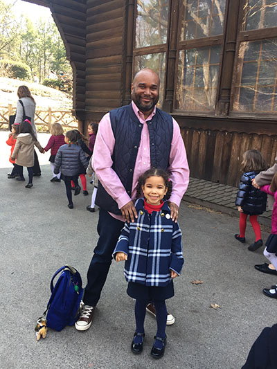 Christopher Persley '91 with his daughter, Camilla, enjoys a class trip to Central Park in NYC that he was chaperoning.