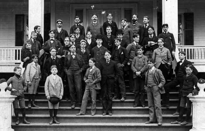 The entire school community, students and faculty alike, on the steps of the Warren House in 1893. Horace Dutton Taft, himself, is in center of the back row.