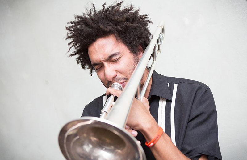 Portrait of Taft alum and trombonist Freddy 'Fuego' Gonzalez '05