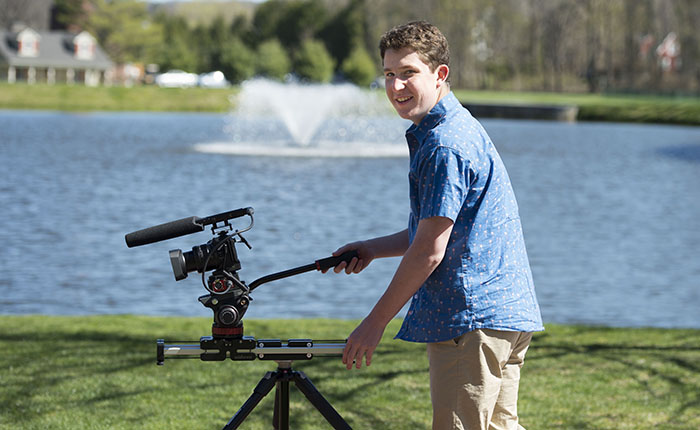 Jack Elrad '17 using a video camera outdoors